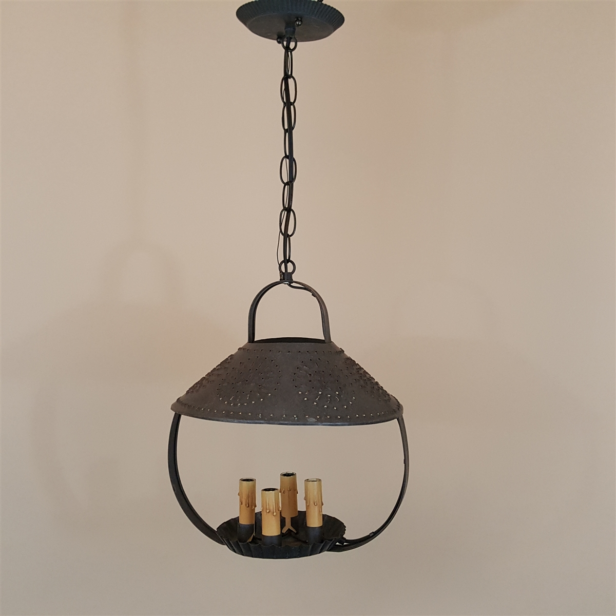 punched tin ceiling light sold
