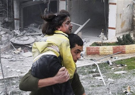 A Syrian man carries his sister who was wounded in a government airstrike hit the neighborhood of Ansari, in Aleppo, Syria, Sunday, Feb. 3, 2013.