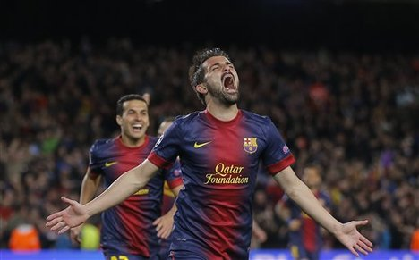 Barcelona's forward David Villa reacts after scoring his side's third goal during the Champions League round of 16 second leg soccer match between FC Barcelona and AC Milan at Camp Nou stadium, in Barcelona, Spain, Tuesday, March 12, 2013.