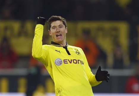 Dortmund's Robert Lewandowski of Poland celebrates after scoring during the German first division Bundesliga soccer match between BvB Borussia Dortmund and 1.FC Nuremberg in Dortmund, Germany, Friday, Jan. 25, 2013.