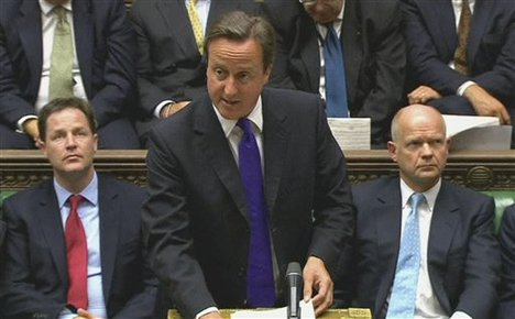 Britain's Prime Minister David Cameron speaks in the House of Commonns in this image taken from TV Monday Sept. 5, 2011. Cameron said a national inquiry into anti-terrorism policy will examine allegations about the cozy ties between U.K. intelligence and Moammar Gadhafi's regime.
