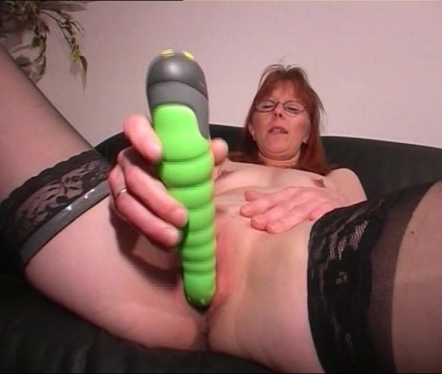 Red Haired Mom Meets The Green Monster Dildo And Fucks Herself With It