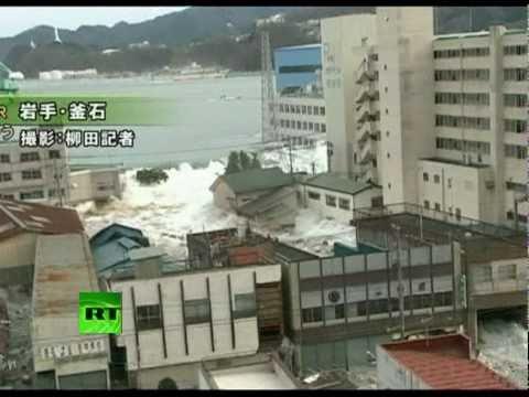 Fresh footage of huge tsunami waves smashing town in Japan