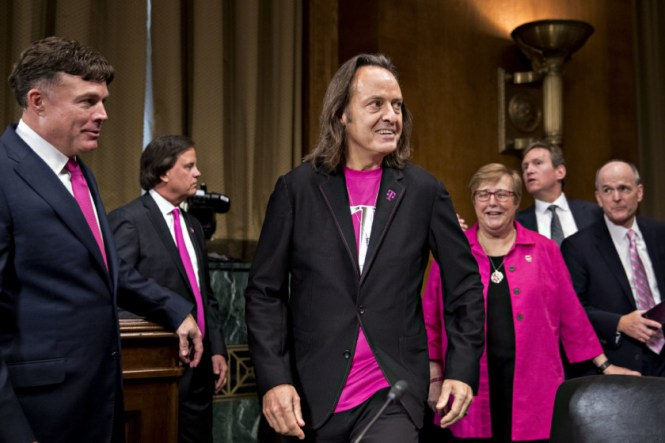 An image of John Legere and other T-Mobile employees at the Senate Judiciary Subcommittee meeting on June 28, 2018.