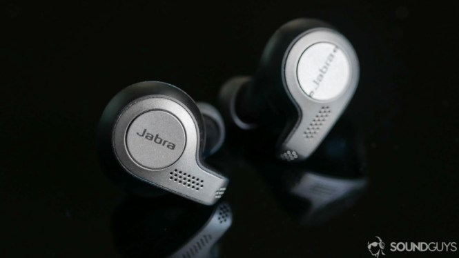 A photo of the Jabra Elite 65t true wireless earbuds on black reflective surface.