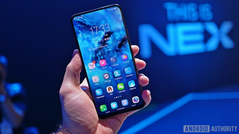 The Vivo Nex with a blue background at a launch event.