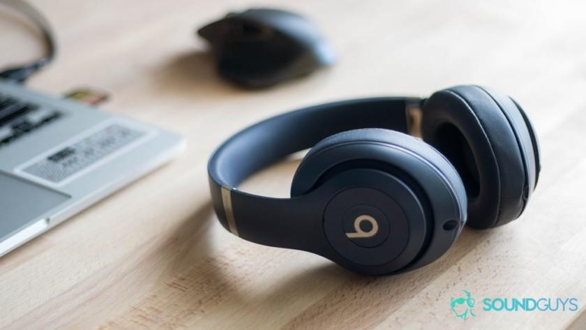 Beats Studio3 in blue on a wooden desk.