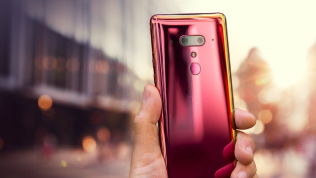 An Image of a hand holding a HTC U12 Plus Flame Red edition.