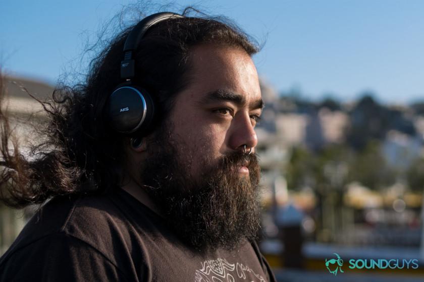 A photo of a man wearing the AKG N60 NC headphones.