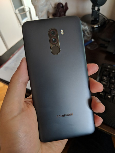 Xiaomi Pocophone F1 from behind in a person's hand.