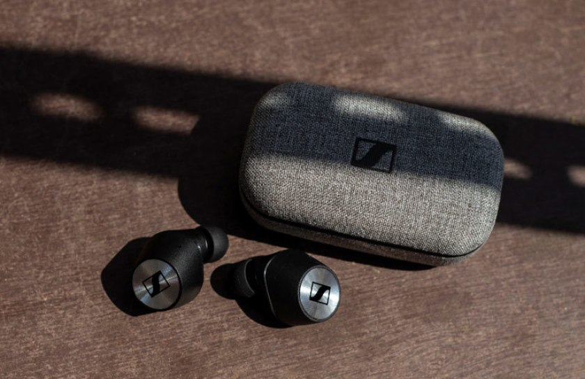 Sennheiser Momentum True Wireless press release image of the earbuds next to the charging case.