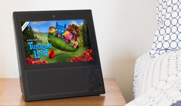 An image of an Amazon Echo Show on a night stand
