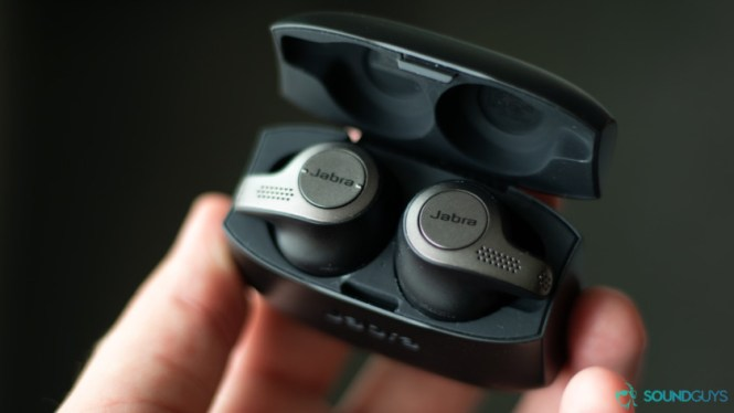 The Jabra Elite 65t in Adam Molina's hand. He holds the carrying case that the earbuds are resting in.
