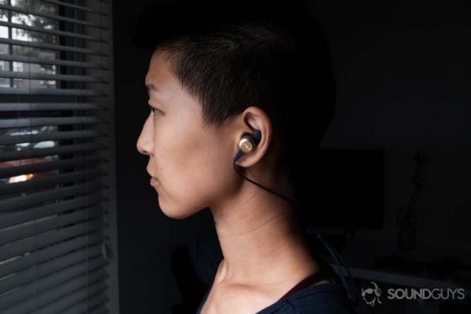 Lily wearing the earbuds to show the housing size.