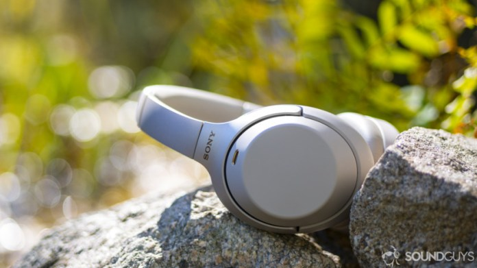 A photo of the Sony WH-1000XM3 sitting on a stone wall.