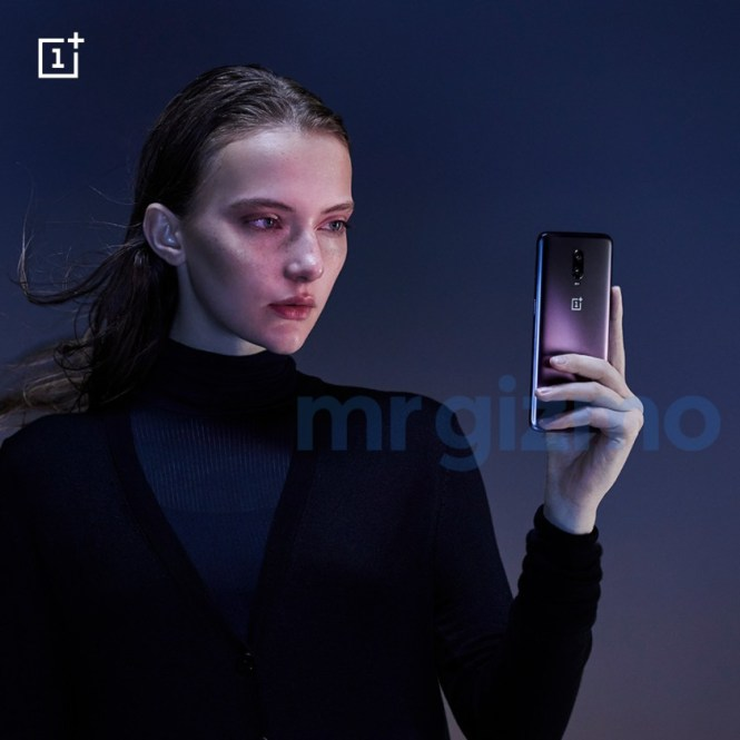 The OnePlus 6T in Thunder Purple in a person's hand.