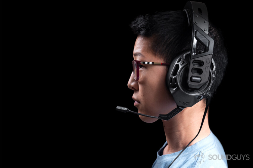 A woman wearing the Plantronics Rig Pro Gaming headset against a black background.