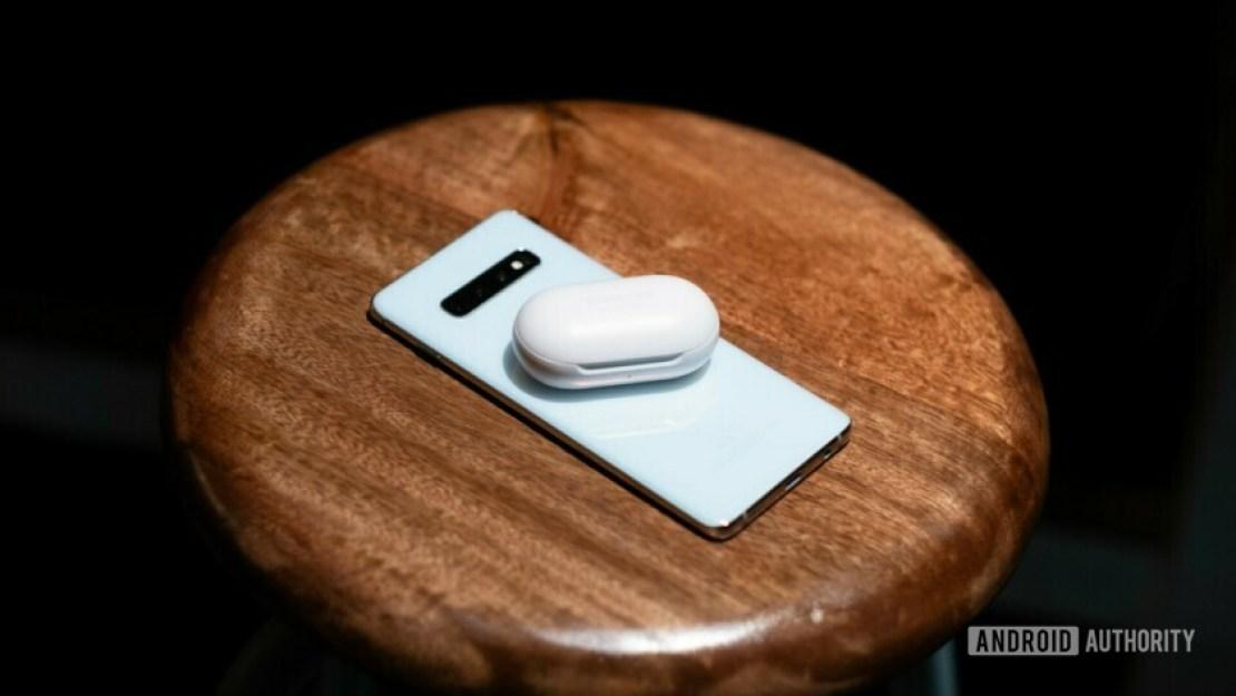 Samsung Galaxy Buds sitting on phone
