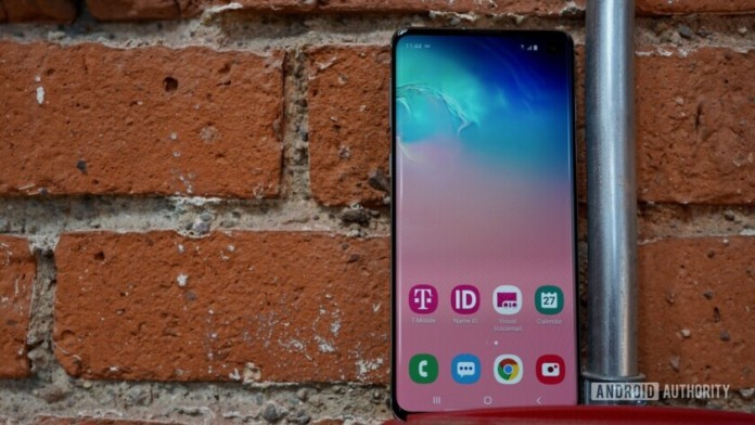 Front side of the Samsung Galaxy S10 against a brick wall.