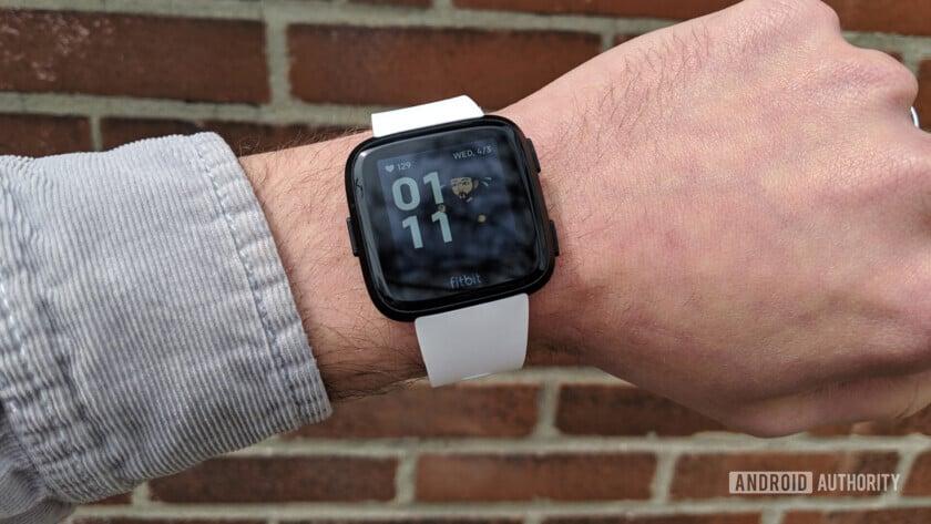 fitbit versa smartwatch with the snapchat bitmoji watch face