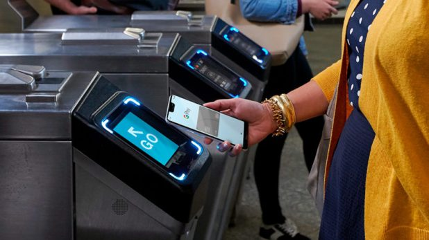 Picture of someone using Google Pay with NYC's OMNY.
