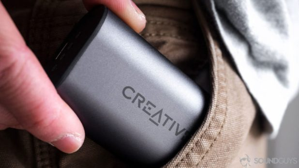 The Outlier Air charging case being inserted into a pocket.