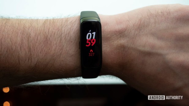 samsung galaxy fit fitness tracker on wrist watch face