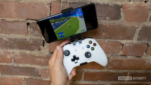 A smartphone clipped to an Xbox One wireless controller.