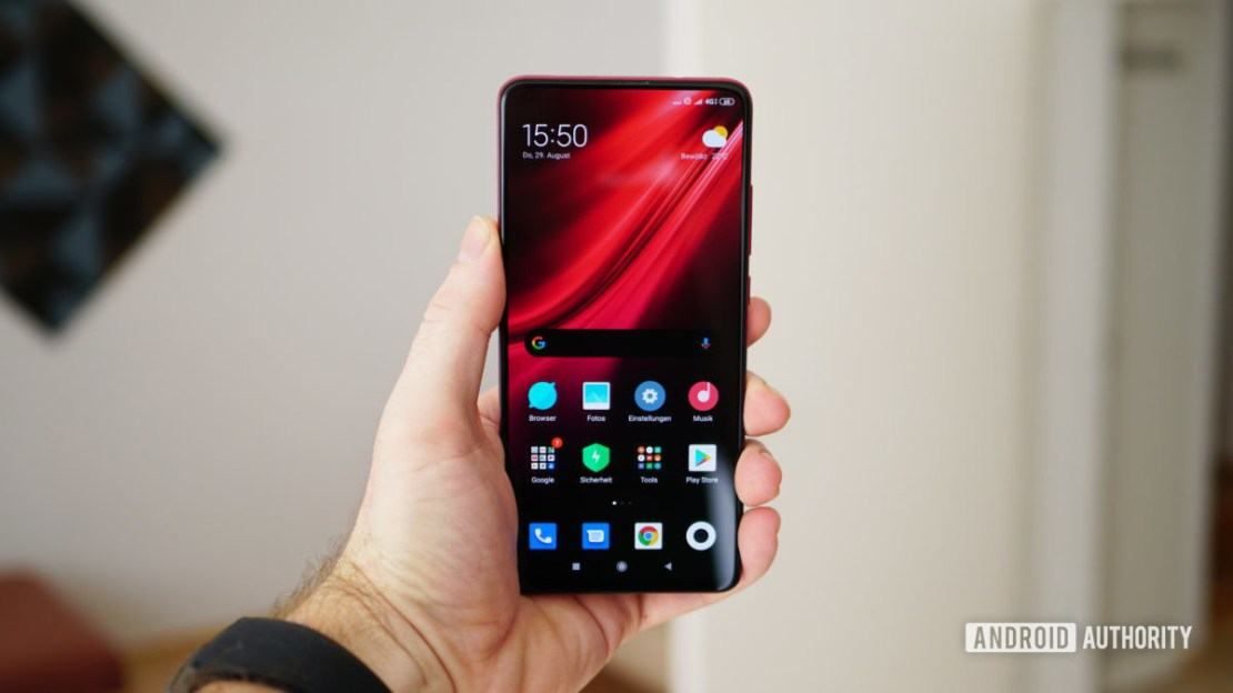 Xiaomi Mi 9T Pro red home screen in hand