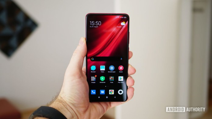 Xiaomi Mi 9T Pro red home screen in hand