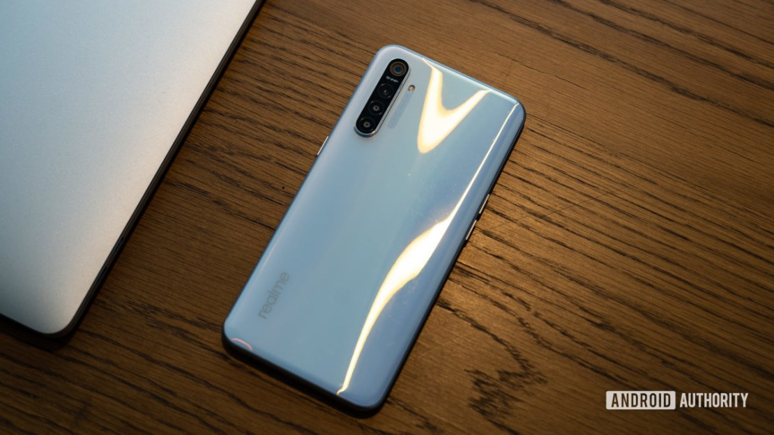 Realme XT on table showing white gradient