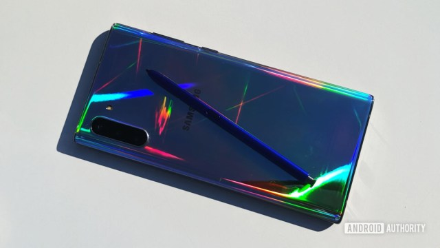 Samsung Galaxy Note 10 and S Pen on table with colored reflections