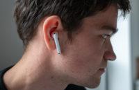Man wearing white Huawei Freebuds 3 in the ear