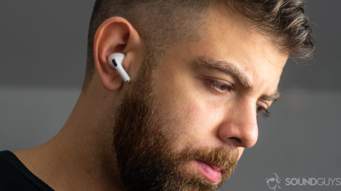 A picture of a man wearing the Apple AirPods Pro noise-cancelling true wireless earbuds.