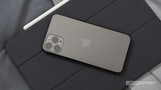 Black iPhone 11 Pro on a gray iPad Pro