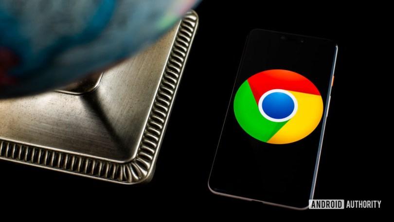 Chrome logo on smartphone next to globe