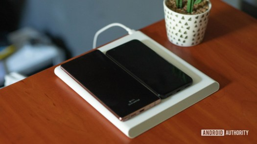 Xiaomi Mi 20W Smart Tracking Wireless Charging Pad with two phones charging