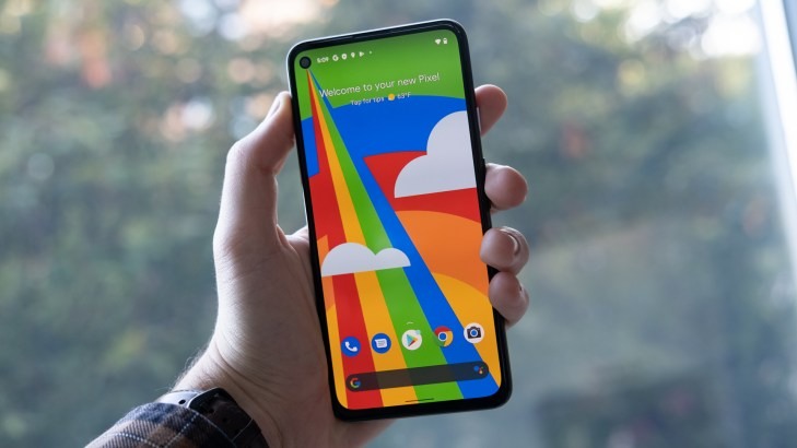 Google Pixel 4a 5G in hand front of phone 1