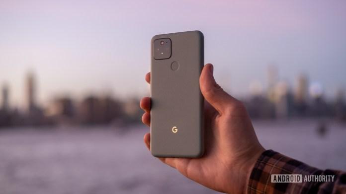 Google Pixel 5 in hand sunset back 1