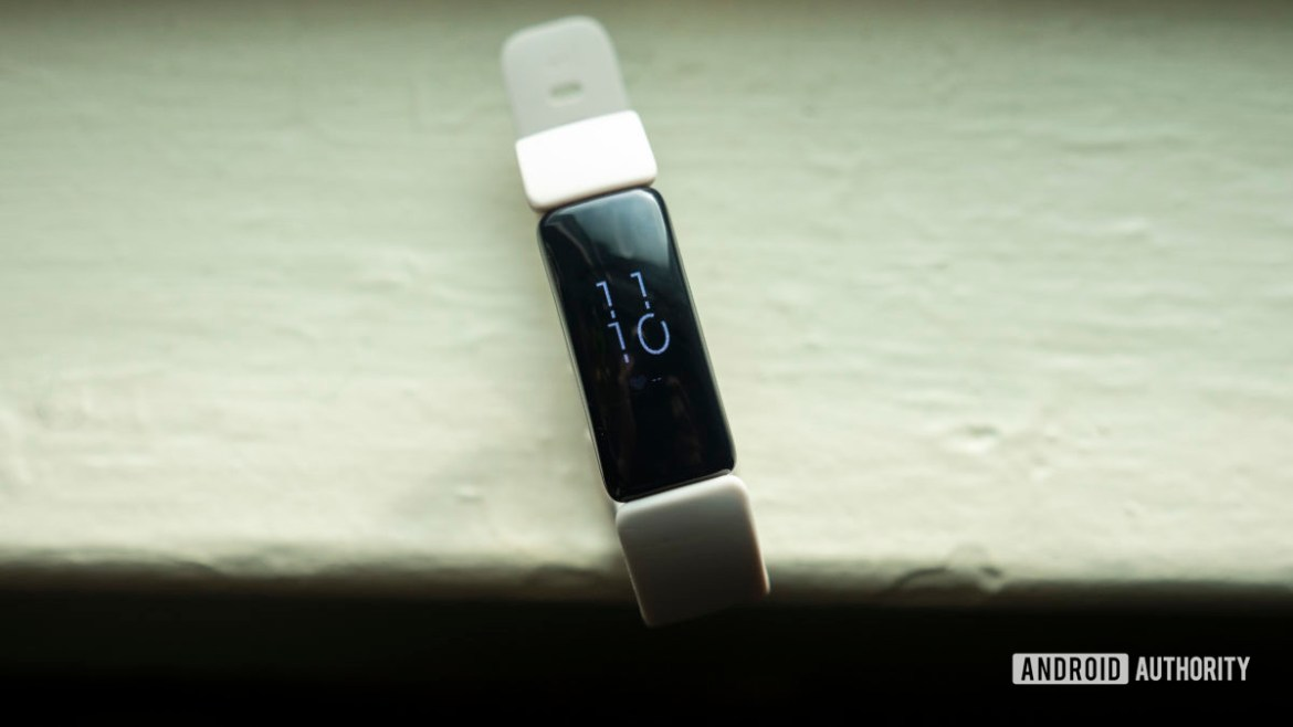 fitbit inspire 2 review fitness tracker display on table 1
