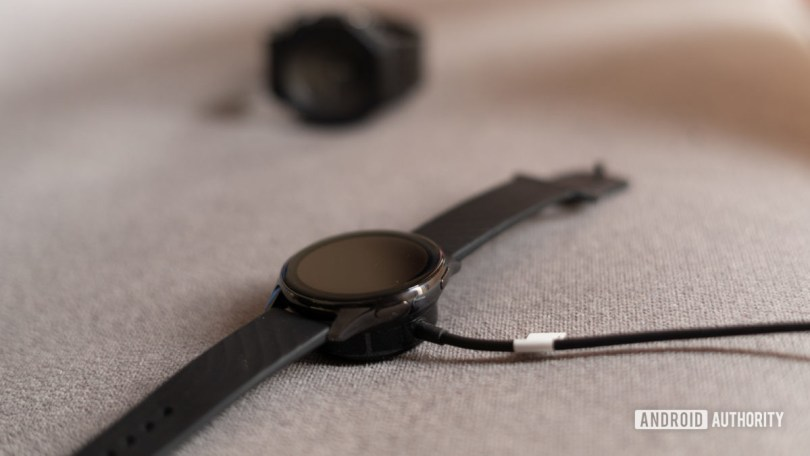 OnePlus Watch on charger