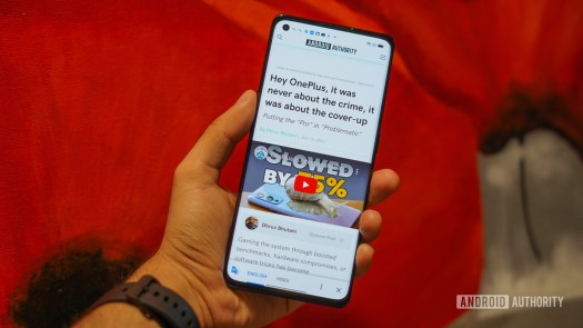 Oppo Reno 6 Pro review in hand with web page open