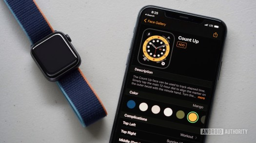 Apple Watch Series 6 and iPhone 11 lay on gray surface illustrating how to add an Apple Watch face in the Watch app