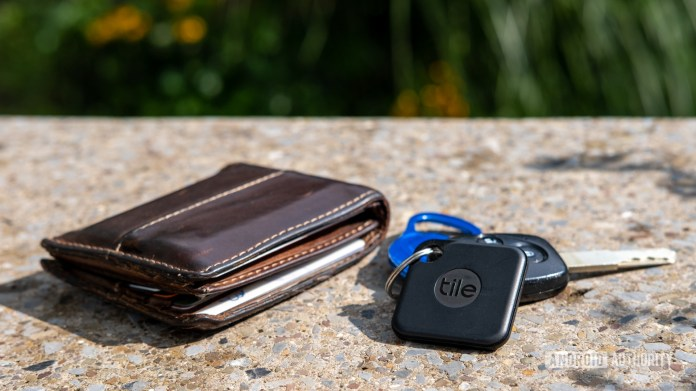 Tile Pro on a keyring next to a wallet