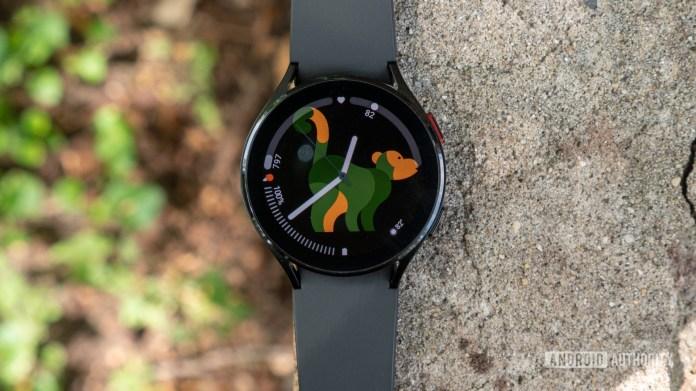The Samsung Galaxy Watch 4 lying flat on a brick.