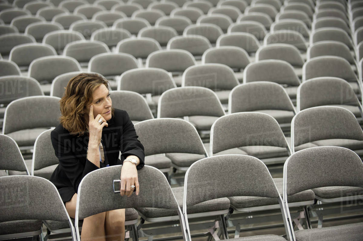 a businesswoman sitting alone