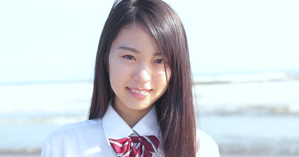 Japanese Girl In School Uniform Smiling At The Camera On D112 71 042