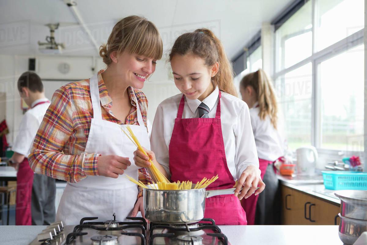 Home Economics Teacher Teaching High School Student Pasta