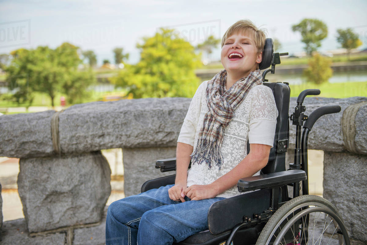 quadriplegic wheelchair bernhardt leather club chair paraplegic woman laughing in stock photo