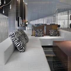 Animal Print Sofas How To Wash A Fabric Sofa At Home Large Modern Sectional With Throw Pillows Stock